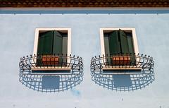 Burano Windows (theseBoetz) Tags: shadow lightblue window italy venice minimalist burano blue babyblue building symmetry venezia roof architecture green wall italia minimal planter