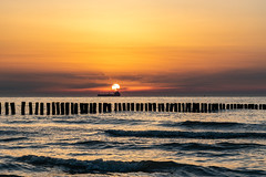 North Sea Sunset (SvenHoenisch) Tags: abend dämmerung europa europe frachtschiff gewässer holland meer netherlands niederlande nieuwvlietbad nordsee northsea schiff seeland sonnenuntergang strand wasser zeeland beach dusk evening sunset water waters