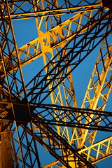 Strength and beauty (James_D_Images) Tags: paris france eiffel tower closeup detail structure lit dusk metal iron lattice geometry shape line shadow abstract sooc gold blue