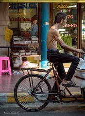 Contrast (Robica Photography) Tags: robicaphotography d3200 2018 streetphotography street men faces cigarette smoking bicycle cart store shop road driving transport thailand streetscene bike