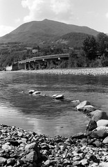 Stone dam (sam.naylor) Tags: italy europe travel medium format film fuji nature mountain mountains hills countryside medieval history stone bobbio town ancient street summer warm 35mm contax g1 rangefinder colour viaduct sky bridge black white monochrime grey ilford fp4