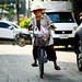 Elderly woman on a bicycle near Warorot Market in Chiang Mai, Thailand