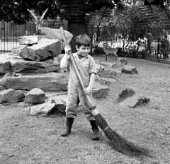 Keeper in training (theirhistory) Tags: boy children kids trousers wellies boots dungarees rubberboots broom zoo rocks