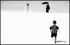 Run for It (explored) (Robert-Jan van Lotringen) Tags: malaysia rendang beach island tropical sand sea people contrast black white umbrella girls child bokeh dof pov highkey holiday tourism sun