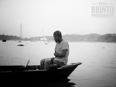 A muslim boatman is praying 😍Remember the Almighty anytime, anywhere.. (syedasir619) Tags: pray muslim boatman dhaka ngc