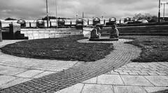 Monk's meeting place. (sheffchris) Tags: sheffield southyorkshire statues meadowhall retail park stone path cobbles
