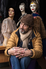 Alex ...  & Co (Charles Hamilton Photography) Tags: glasgow glasgowcharacter glasgowstreetportrait glasgowstreetphotography thebarrasmarket thebarras eyecontact markettrader nikond750 naturallight primelens peopleinthecity people portrait expression clothes mannequin colourstreetportrait characterstudy charleshamilton