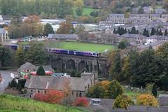 Northern Rail 158 crosses Marshfield Viaduct in Settle with the 1M53 Leeds to Carlisle service on a cold dull autumnal morning 27-10-18 © (steamdriver12) Tags: yorkshire north west riding frosty autumnal northern rail 158 sprinter crosses marshfield viaduct settle 1m53 leeds carlisle service cold dull morning diesel multiple unit england trees townscape