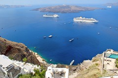 Fira, Santorini, Greece (Chanel Debono) Tags: santorini greece greekisland greekislands greek island islands thera thira cyclades aegean aegeansea hills cliffs sea beach beaches sand summer blue ferries hellenic hellenicseaways ferry trees cactus flower flowers gazebo hotel boats ships quadbike atv quads quadbikes bike windmill windmills maintown town holiday travel travelling lovegreece visitgreece greecetrip islandhopping discovergreece travelphotography canon canon600d canonphotography chaneldebono church churches traveler wanderlust travellingtheworld photography nature bluesky europe volcano volcanic caldera fira