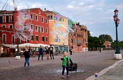 Bubbles in Venice - Street life on the waterfront. (One more shot Rog) Tags: bubbles bubble bubblesgalore venice venetian blow waterfront onemoreshotrog entertain kids playing italian italy pop pops catch soap street streetlife