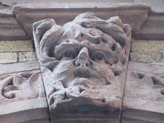IMG_4804 (Brechtbug) Tags: broken nose gargoyle with bushy eyebrows above doorway building facade 25th street between 7th 8th avenues brownstone entrance nyc 11122018 new york city midtown manhattan 2018 gargoyles portraits monster portrait monsters creature faces spooky art architecture sculpture keystone mask brownstones brown stone