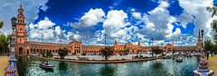 Plaza de Espana (Juan-Chaves) Tags: plaza square españa spain sevilla seville andalucia andalusia europa europe afternoon cielo sky nubes clouds gente people fuente fountain monumento monument arte art arquitectura architecture farolas streetlights rio river estanque pond barcas boats momentos moments romantico romantic otoño autumn fall luces lights reflejos reflections reflectionwater amor love torre tower bandera flag panoramica panorama