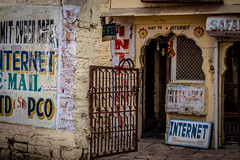 Doorway to Internet (shapeshift) Tags: 50mm d5600 in arch asia davidpham davidphamsf documentary doorway entrance gate handpainted handpaintedsigns india internet nikon rajasthan shapeshift shapeshiftnet signs southasia travel jaisalmer