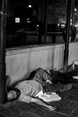 Belly full of pizza (ceruleansnake) Tags: atx austin tx city downtown night life nightlife 3am bw black white sleeping homeless man pizza 6th sixth street bnw