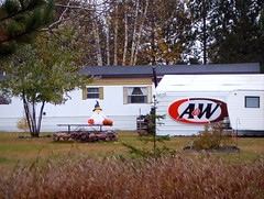 Halloween in the trailer court (yooperann) Tags: aw rootbeer sign ghost pumpkins outdoor decor little lake new swansey upper peninsula michigan fall autumn
