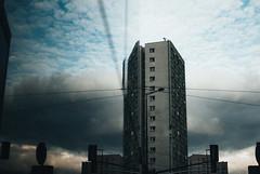 Skyline (ewitsoe) Tags: 35mm city cityscape nikond80 street warszawa erikwitsoe pedestrians summer urban warsaw reflection building architecture buildings skyline clouds weather rain grain sky