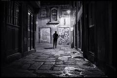 Follow Me (frankmartinroth) Tags: 35mm f20 sony rx1r sonnart235 outdoor wide urban portugal porto monochrome bw darkness night buildings shadows graffiti city silhouette people street