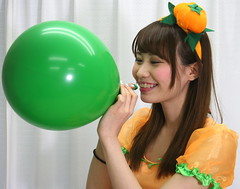 Now Pumpkin Lass Thinks (emotiroi auranaut) Tags: smiling girl woman lady model gorgeous beautiful pretty adorable attractive female feminine femininity halloween pumpkin orange green toy balloon air fun tease teasing play playing playful braces smile grin grinning