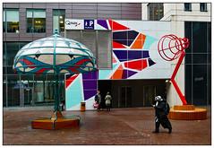 A bit murky (donbyatt) Tags: manchester sculptures art installation lamps acrylicize street urban wet candid people