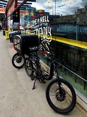 Welcome to Hell (Steve Taylor (Photography)) Tags: hellpizza discbrake topbox crossbones chopper delivery bike bin sign window fastfood black red yellow orange glass newzealand nz southisland canterbury christchurch cbd city reflection perspective bicycle cycle