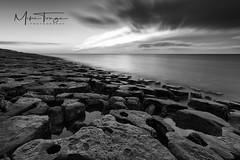 The emerging landscape! (miketonge) Tags: limestone limestonepavement lownewton northumbria seascape sea water rock jigsaw mono d850 blackandwhite sunrise tide cloud longexposure