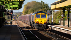 GBRf Class 66/7 no 66787 at Worksop Station on 18-10-2018 with a loaded coal train from Immingham to West Burton Power Station (kevaruka) Tags: worksop station nottinghamshire sherwood forest october 18102018 autumn sun sunshine sunny day colour colours color colors class 20 56 66 choppers grid shed trains train rhtt freight network rail british yellow blue green composition locomotive heritage historic market town england canon eos 5d mk3 70200 f28 is mk2 5d3 5diii flickr thephotographyblog telephoto railway railfreight 20205 20007 railroad tree