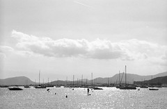 Memories of summer (ronet) Tags: pentaxmz5n spain blackandwhite clouds ilford ilfordfp4 mallorca mountains portdepollensa scanned sea sky sunshine