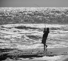 Striper on the line (Dalliance with Light (Andy Farmer)) Tags: jersey beach ocean monochrome asburypark water silhouette bw striper fishing shore neptunetownship newjersey unitedstates us