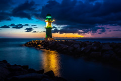 A Matter of Time (b.adolphi) Tags: lighthouse coast sea clouds sunrise stones waves bluehour blue purple magenta yellow light mecklenburgvorpommern ostsee balticsee warnemünde marnemünde rostock molenfeuer sky ocean water dusk