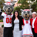 Truman Scholar Ashley Lawson and NC State Education Dean Mary Ann Danowitz pose with Mr. & Ms. Wuf