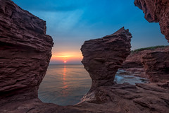 Sunrise at Thunder Cove (B.E.K. Photography) Tags: thunder cove darnley pei prince edward island outdoor landscape sunrise rock formation seastack sun early dawn gulf saint lawrence canada nikond600 nikon1735f28 red blue orange beach sea water seascape high tide cliff sky