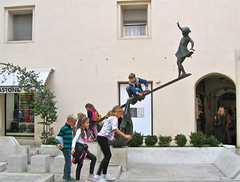 Look at me up here! (vittorio vida) Tags: children play games acrobat street statue vicenza