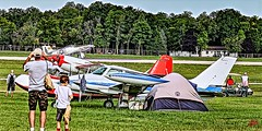 FLY-IN YOUR TWIN . . . CAMP FOR THE WEEK . . OSHKOSH AIR SHOW 2018- (panache2620) Tags: oshkoshairshow oshkosh camping airplanes planes aircraft airshow group crowd spectators eos canon candid