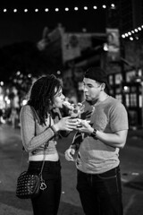 Mmm I like yours (ceruleansnake) Tags: atx austin tx texas city night life nightlife sixth 6th street downtown pizza man woman couple sharing food standing people black white bw