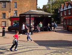 Bus stop (Snapshooter46) Tags: busstop churchsquare tring childrenplaying