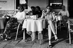 Lunch. (markfly1) Tags: venice italy women doing lunch legs shoes sunglasses street candid image cafe culture wine smoking lady cigarette cigarello table chairs cloth men restaurant glass drinks relax nikon d750 35mm manual focus lens