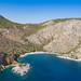 Aerial view of Nikolaos Beach bay Hydra