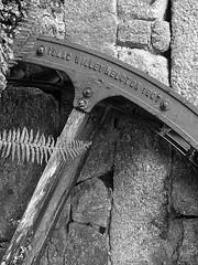 Lamorna (leavesandpuddles) Tags: blancetnoir blancoynegro biancoenero blackandwhite bw monochrome schwarzundweiss cornish cornwall kernow penwith lamorna closeup waterwheel mill granite wheel