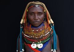 Portrait of a Mumuhuila tribe woman, Huila Province, Chibia, Angola (Eric Lafforgue) Tags: adult africa africantribe angola angolan bead beads blackbackground caurishell chibia colourimage cultures day developingcountries dreadlock ethnicgroup hair hairstyle horizontal huila indigenousculture jewellery lifestyles lookingatcamera muila multicolored mumuhuila mumuila mwila necklace nyaneka oneadultonly oneperson onewomanonly ornament ornate outdoors photography plait portrait traditionalclothing tribal tribe angango3074 huilaprovince