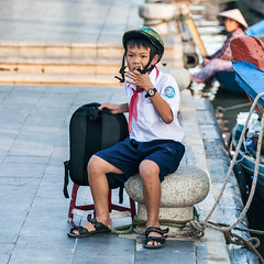 Chewin' on strap (petemenzies.com) Tags: boy schoolboy vietnam hoian travel asia streephotography streetportrait school uniform rucksack helmet strap people
