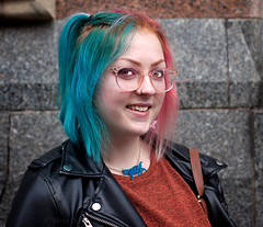 Rhia - stranger 178/200 (englishreader) Tags: 100strangers strangers stranger strangerphotography street streetphotography streetportrait streetportraiture people peoplephotography portrait portraitphotography portraiture headshot thehumanfamily female woman women lady ladies youngwoman younglady girl girls daylight availablelight naturallight 50mmlens primelens canon nottingham hair colouredhair leatherjacket glasses spectacles necklace catnecklace cat smile smiling happy nosering nosepiercing leather building wall blue pink brown rust black grey gray