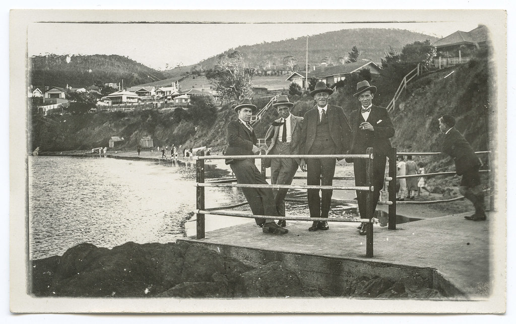 Sandy Bay - four men in suits on concrete sea wall at Blinking billy Point (?) - view south down beach shows houses on top side (c1924)