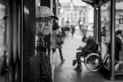 Doorways (Leanne Boulton) Tags: people urban street candid portrait portraiture streetphotography candidstreetphotography candidportrait streetportrait eyecontact candideyecontact streetlife old elderly aged man male face eyes expression mood feeling atmosphere doorway cap wheelchair homeless beggar background juxtaposition tone texture detail depthoffield bokeh naturallight outdoor light shade shadow city scene human life living humanity society culture lifestyle canon canon5dmkiii 70mm ef2470mmf28liiusm black white blackwhite bw mono blackandwhite monochrome glasgow scotland uk