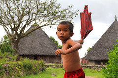 Boy in front of Traditional Houses in Ruteng, Manggarai (alida behind the camera) Tags: komodo flores indonesia east southeastasia asia nationalpark islands tropicalisland komododragon sea coral reef dive diving snorkeling underwater sealife wildlife boat landscape travel photography