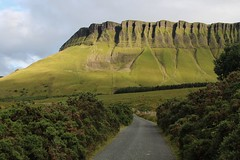 Roadway leading to Benbulben Mountain (flxnn) Tags: beauty amateur ireland grassland grass outdoor mountain plateau green rural road roads countryside color colour travel hiking hills destination explore summer sunlight evening nature natural rock rocks limestone ridge paysages landscape landschaft landmark farmland