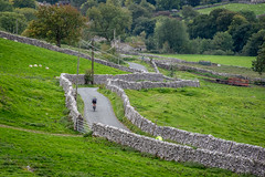 Lone Cyclists (Charlie Little) Tags: malham northyorkshire yorkshiredales cycling stonewall landscape nikon d7200