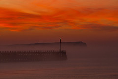 east pier sunrise 1 (photoautomotive) Tags: newhaven eastsussex england englishchannel sussex sunrise seafordhead eastpier pier port harbour water sky sea seaford fog mist ripples reflection silhouette outside outdoor seafordbay clouds cliff canon 7d 35350l