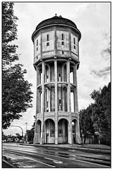 Emden, water tower (unukorno) Tags: emden watertower wasserturm sw bw blackwhite monochrome noise street clouds trees frame afterrain