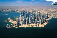 Doha city view (anekphoto) Tags: view aerial city plane tourism qatar window travel landscape airplane doha blue aircraft sky cloud high transportation horizon air wing dawn through water technology frame sea looking sun up horizontal clear sunlight transport land vehicle sunrise commercial journey desert over vacations coastline flying engine cloudscape class destinations above jet passenger