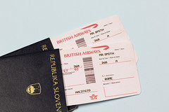 Plane tickets lying in passport (wuestenigel) Tags: boarding traveltheworld tickets passport documents plane travel transport business geschäft money geld finance finanzen currency währung paper papier noperson keineperson document dokument identity identität wealth reichtum financial finanziell reisepass bank commerce handel cash kasse pay zahlen shopping einkaufen savings ersparnisse debt schuld investment investition text
